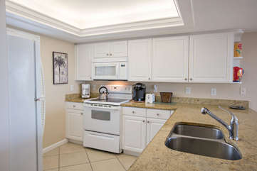 Open kitchen perfect for cooking with all of the utensils and cookware one needs for a perfect stay!