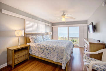 Gorgeous master suite with flat screen tv, direct gulf front views.  Coastal bedding and high end mattress.
