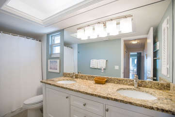 The guest bath with dual sinks and a shower / tub combination.