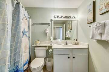 Guest/bunk bed area bathroom connected directly to bunk bed area with full washer and dryer located in it