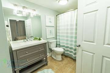 Enjoy the seaside feel of this full bathroom