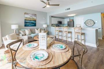Coastal, comfy, and complete dining area for a family of four.