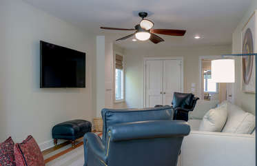 The bonus room has a large flat screen HDTV and a queen size sleeper sofa.