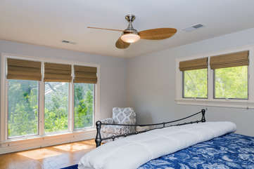 The master bedroom is filled with natural light.  A great retreat!