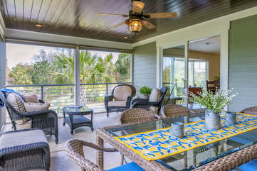 A large screened porch is on the second floor. Here you can relax and breath in the ocean air or dine at the table for six.