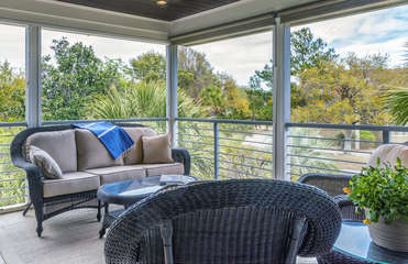 Watch the world go by with not a care from this second floor screened porch.