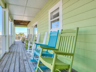 Relax on the full length side porch, rock you worries away!