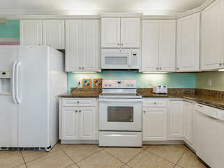 Kitchen with all the fixin's. Stovetop, oven, microwave, refrigerator!
