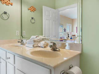 Full bath has private entrance from bedroom and TWO sinks.