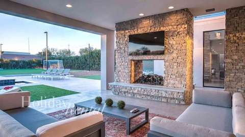 Catch a game outside in this lavish outdoor living room