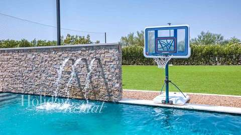 Swim Up Basketball in the pool. Water feature in pool with soccer in the backyard