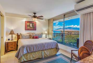 Spacious guest bedroom with partial ocean and mountain views