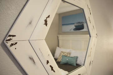 Bedroom with a mirror over outlet in case someone is in the bathroom- it's never fun having to wait on someone to get ready, so we've got you covered!
