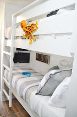 Super fun bunk area for the kiddos! Built in TV and Smart Bluray player with free Netflix included! We have expanded the bunks in all of our properties to as wide as fire code allows (smaller than a twin).