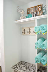 Entry way shelves and hooks with your beach/pool towels just asking to be used!!