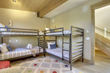 Main level bunk room with 4 twin beds