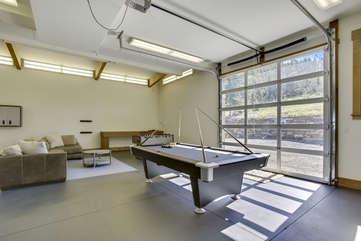 Huge game room  with custom glass rolling door