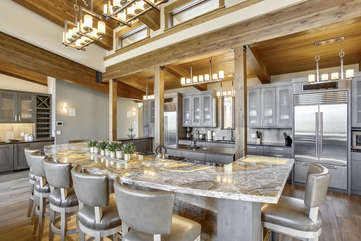 Fantastic chef's kitchen with LED lights in the slab granite counter bar