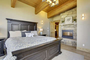 Master bedroom with 2 way stone gas fireplace