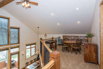 Upper level loft with game table that seats four