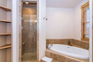 Walk- in shower and jetted tub in the main level master bathroom