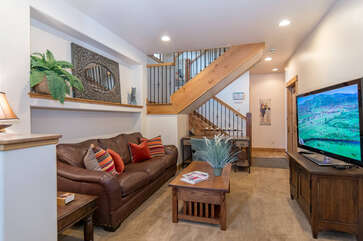 Second living area on lower level with large flat screen TV