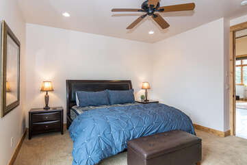 Main level master bedroom with King hosting new bedding