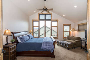 Open the french doors to the upper level master bedroom