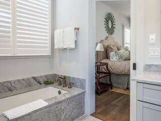 En Suite master bath is spacious and spa-like with soaking tub