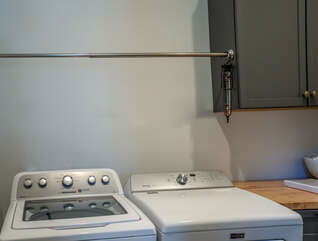 The laundry room is located off the kitchen in the mud room.  There is a new top load washer and dryer.