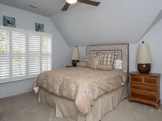 The second floor guest bedroom has a queen size bed.