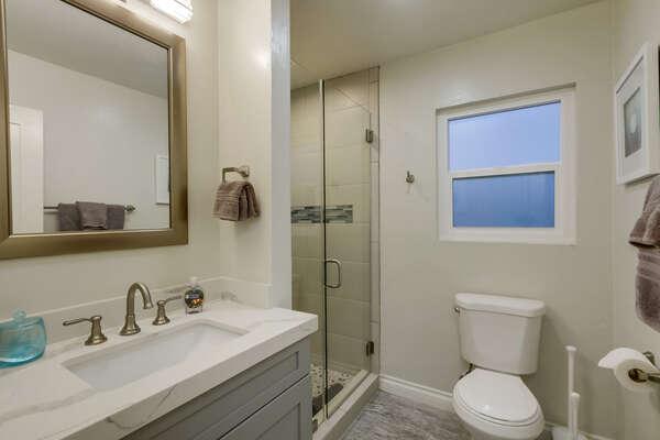 Bathroom with shower, hallway access