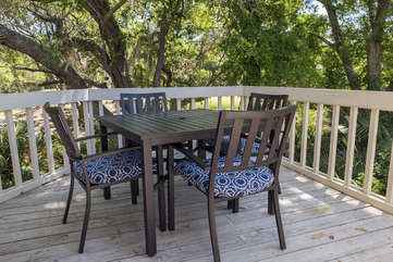 Enjoy dining outdoors on the first level deck.