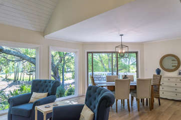 The main level has floor to ceiling windows which flood the dining and great room with light.