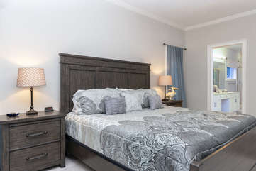 First floor master bedroom is off the great room.  It features a king bed and en-suite bath.