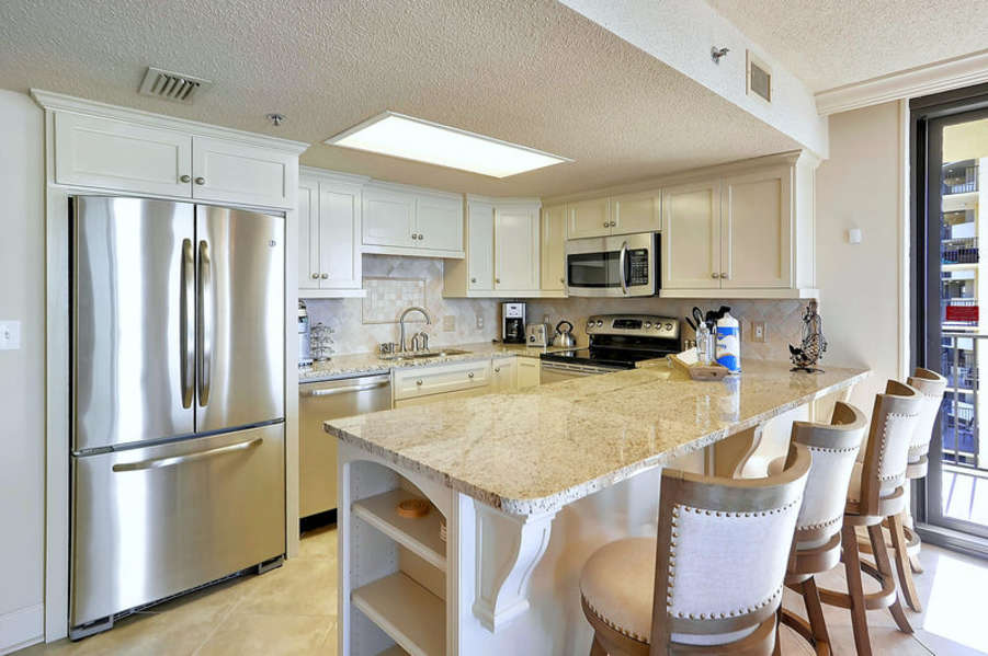 Breakfast Bar and Magnificent Kitchen with Stainless Steel Appliances and Granite Counter Tops