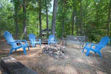 Fire Pit , near the shore on the flat wooded lot