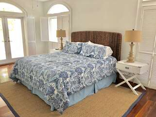 Cheerful and bright first floor master bedroom with king bed