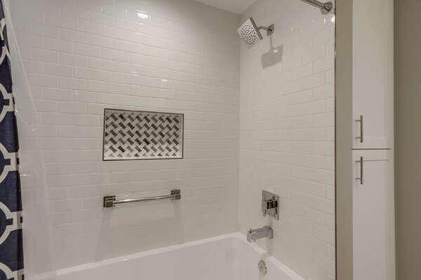 Ground floor full bath, tub/shower combo.