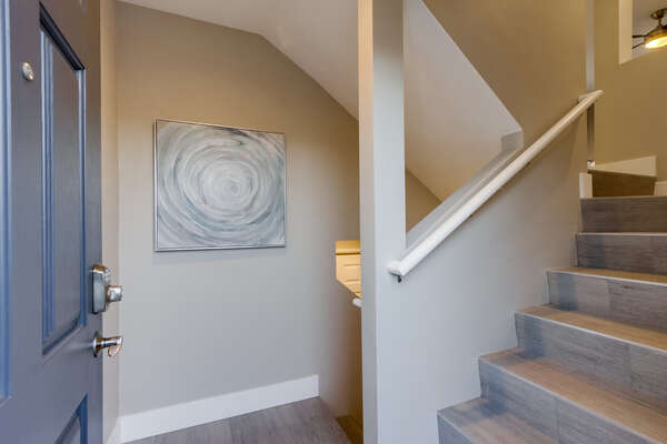 Entrance through the side, stairs up to the 2nd floor to the kitchen and living area or down to the 2 bedrooms.