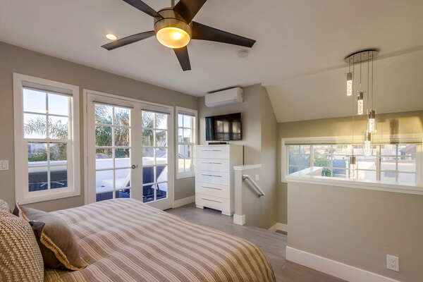 Master bedroom with deck, (3rd floor) (does not have a bedroom door from the stairs, loft like)