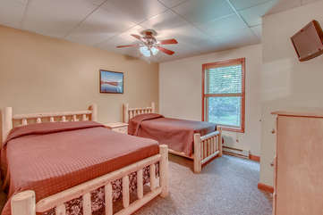 One of two bedrooms on 1st floor, one double and one twin bed