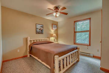 One of two bedrooms on 3rd floor with queen bed