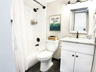 Remodeled and CLEAN Bathroom!  We have also updated the countertop to extend over the toilet for some extra room!