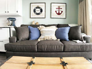Queen sleeper sofa is shown with memory foam topper! Quilt, sheets and pillows in the trunk!