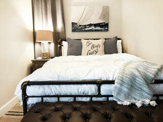 Comfortable Queen size bed!  We also provide a sound machine and alarm clock!