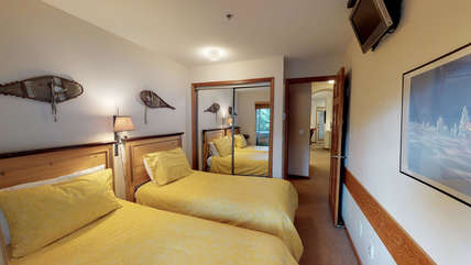 Second bedroom featuring two twin beds (second bathroom across the hall)