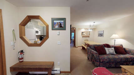 Large entry with seating and storage room