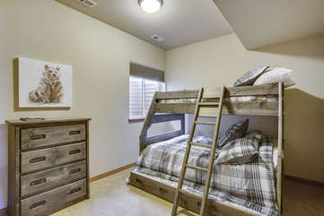 Bunk bed room, consists of a full mattress on bottom and a standard twin on top. Full size trundle bed below. Great for one large family of kids or two families to share.