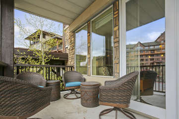 Large covered private patio with custom furniture